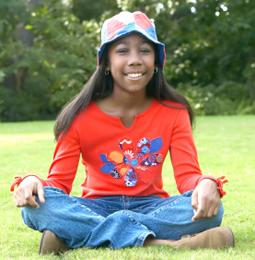 girl sitting crosslegged in smiling